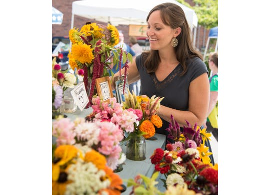 Ashtabula Farmers Market woman with flowers