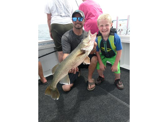 DB Sport Fishing fish and child